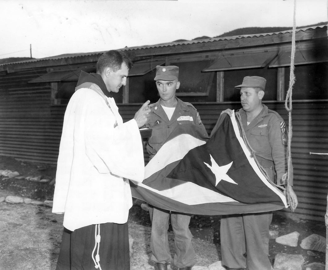 13. Chaplain blesses PR Flag in Korea 1952.300